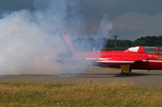 Belgian Fouga Magister making a lot of smoke