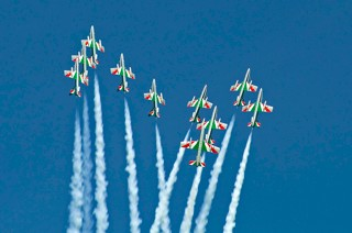Frecce Tricolori splits in two formations for the Big Apple figure while the solo display aircraft separates the formation