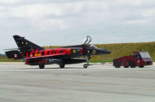 Dassault-Breguet Super Étendard, 15, 11F being towed by a truck in the same red and black tiger colours