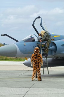 Armée de l'Air EC.01.012 Pilot wearing a long haired blond wig stepping in his MIrage 2000C, during the 2008 NATO Tiger Meet at BAN Landivisiau