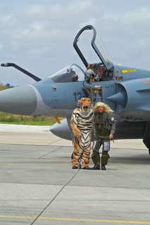 Armée de l'Air EC.01.012 Pilot wearing a long haired blond wig and a crew-chief in a tiger outfit in front of a MIrage 2000C, during the 2008 NATO Tiger Meet at BAN Landivisiau