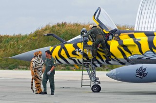 Blond bleaked pilot stepping into Mirage 2000C, 12-YB / 99, EC.01.012